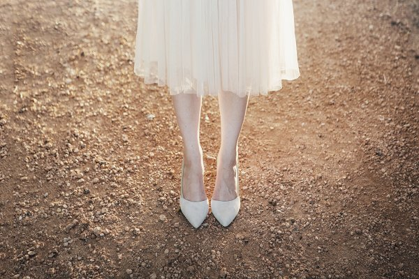 Woman's Feet in Heels on a Dirt Roa…