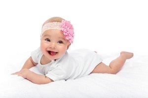 happy beautiful baby girl in white