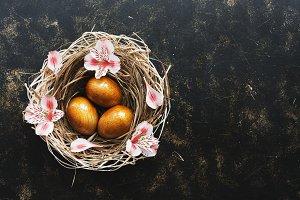 Golden Easter eggs in a nest