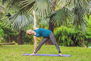 woman practicing yoga in a tropical