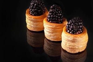 Blackberry berries in dough barrels