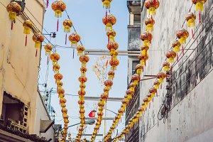 Red Chinese lanterns hang between