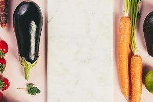 Fruits and vegetables on pink backgr