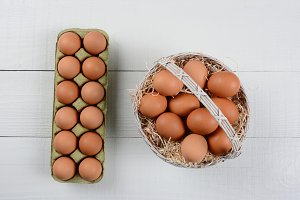 A basket and carton of brown eggs re