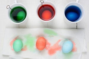 Dyed eggs drying on a paper towel wi