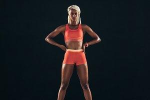 Woman sprinter standing on a running