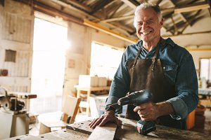 Senior male carpenter working