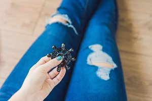 Girl teenager in holey jeans holds