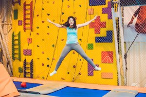 Young woman sportsman jumping on a