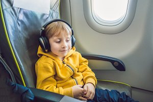 Boy with headphones watching and