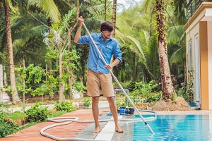 Cleaner of the swimming pool . Man