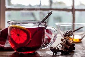 Tea with lemon on table with windows