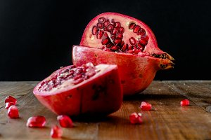 Pomegranate apple on wooden table