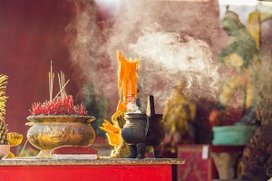 Incense sticks on joss stick pot are