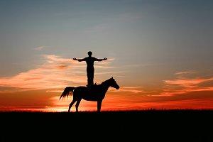 Inspired man, standing on horse