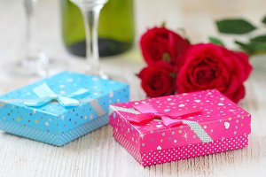 Fresh red roses and gift boxes