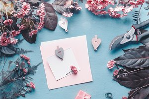 Greeting card on desk with flowers