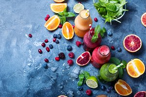 Colorful detox smoothie in bottles