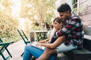 Young couple sitting embraced in the