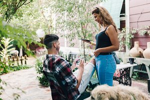 Young couple and their dog sitting s
