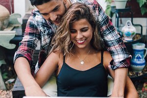 Smiling young couple sitting embrace