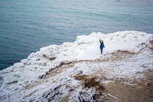 Girl feeding seagulls on the frozen