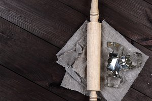wooden rolling pin and iron bakeware