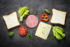 Ingredients for sandwich on a black