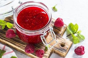 Strawberry jam in glass jar.