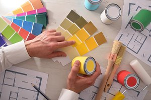Decorator choosing a color in office
