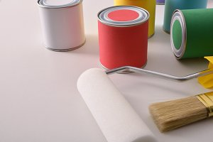 Paint pots and tools on white table