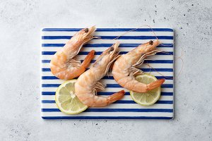 Cooked tiger prawns on striped plate