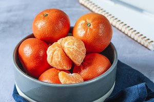 Clementines and notebook