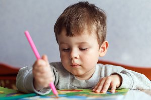 Little boy drawing with color