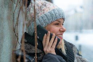 Cute girl smartphone winter