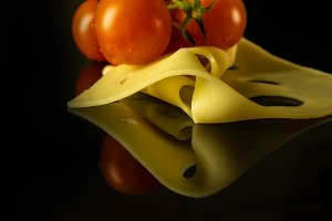 Cherry tomatoes and cheese.
