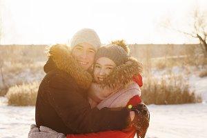 Teenagers in love. Date in winter
