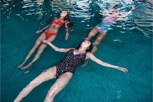 Young slim women training in