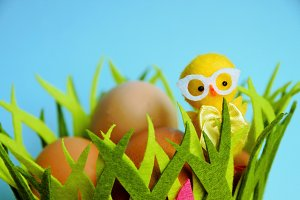 Cute Yellow chicken with Easter eggs