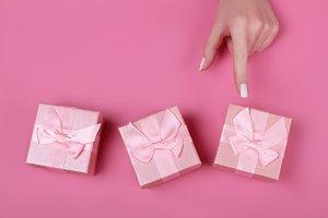 woman chooses pink gift box