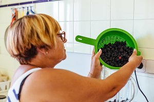Woman preparing blackberry jam