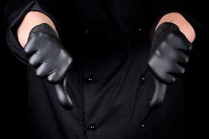 chef in black latex gloves
