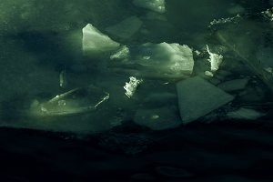 Ice in shadows in shades of green