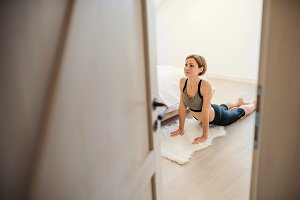 A young woman doing exercise indoors