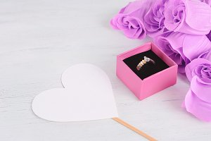 Golden diamond ring in pink box with