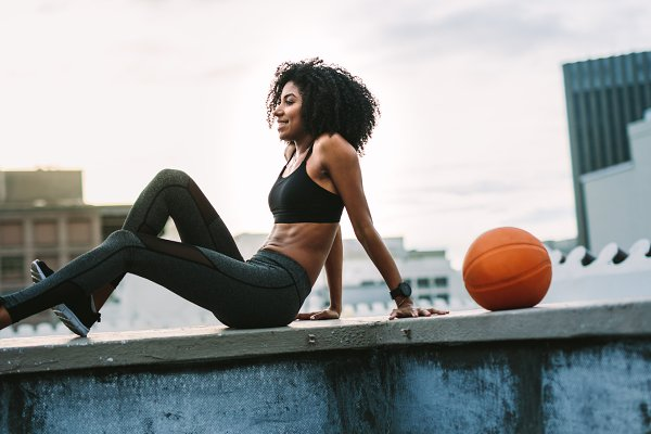 Female athlete relaxing on the roof