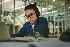 Student with headphones studying