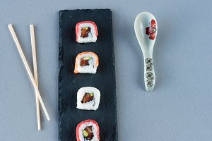 Sushi ready to eat on slate plate