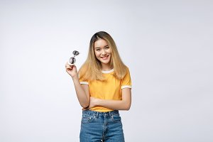 Young happy Asian woman smiling in