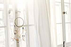 Dream catcher hanging in window
